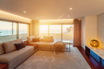 Modern living room interior. Sunset in big window