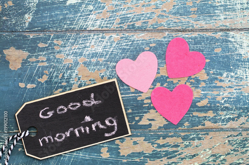 Good Morning Written On Mini Blackboard With Three Pink Hearts Rustic Surface