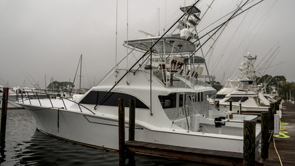 Luxury fishing boat at dock on a foggy morning.