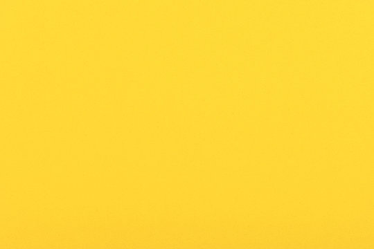 Bright yellow velvet paper texture background