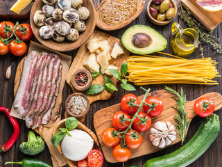Variety of popular Italian food on wooden background. Top view.