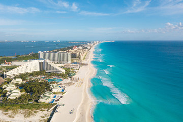 Cancun aerial view. Zona hotelera Cancun beach panorama top view. Caribbean seaside beach with turquoise water and big waves. Yucatan, Quintana Roo, Mexico