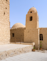 Tower and dome of the Church of St. Paul & St. Mercurius, Monastery of Saint Paul the Anchorite, dates to the fifth century AD and located in the Eastern Desert, near the Red Sea mountains, Egypt