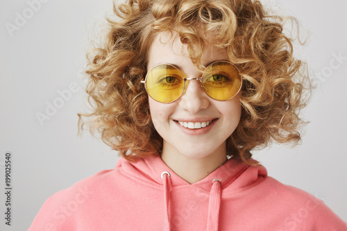 Fashionable Attractive Curly Haired European Woman With Trendy