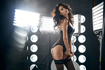 Sensual lady wearing sexy, black lingerie