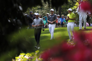 U.S. golfers Walker, Rickie Fowler and Zach Johnson walk down the 6th fairway during practice for the 2018 Masters golf tournament in Augusta