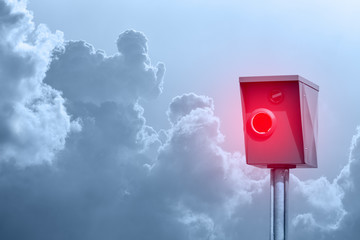 A typical radar trap, speed trap, speed camera in front of cloudy sky