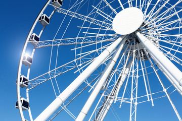 White ferris wheel over a blue sky
