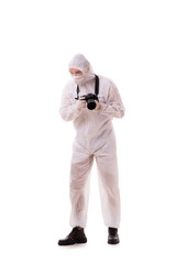 Forensic specialist in protective suit taking photos on white
