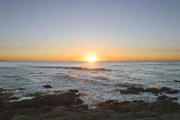 Sun Rising in the middle of a rocky sea at Punta del Este, Uruguay