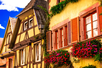 Fototapete - Colorful traditional half-timbered houses of Alsace in France
