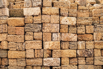 Building blocks from sandstone. Rough texture of bricks made of sand and seashells.