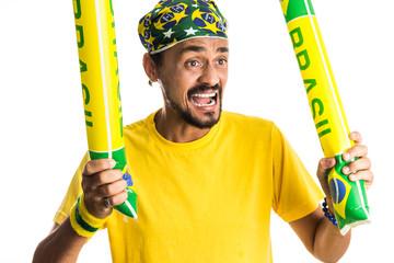 Brazilian man fan celebrating on footbal match on white background. Brazil colors.