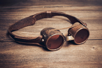 Steampunk or cyberpunk glasses on a wooden table.