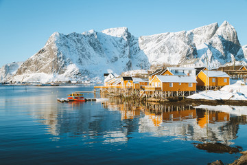 Wall Mural - Lofoten Islands winter scenery with traditional fisherman Rorbuer cabins, Sakrisoy, village of Reine, Norway