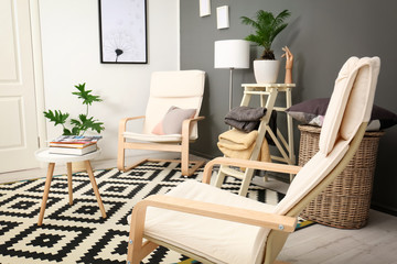 Stylish interior design with tropical leaves