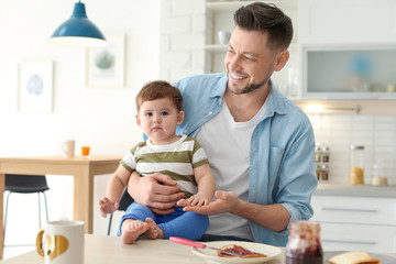 Dad and son at table in kitchen