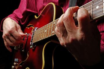 Guitarist hands and guitar close up. playing electric guitar. play the guitar.