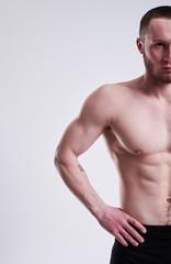 cropped studio shot of strong man