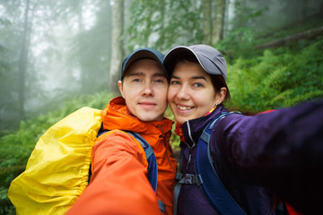 Photo of young couple with backpack