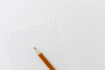 Blank white paper with pencil on a white desk. High quality graphic collage.