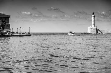 Boat, lighthouse and seascape, Crete, Greece