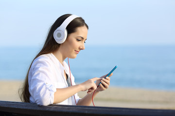Girl listening to music and choosing song on line