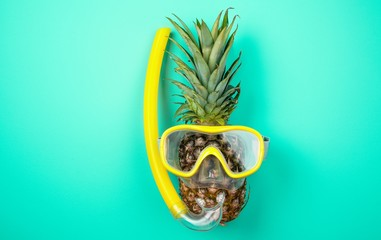 Pineapple in a snorkeling mask