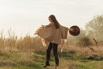 Cowgirl in the meadow field