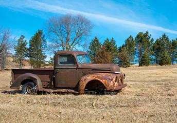 Rusty old truck in field