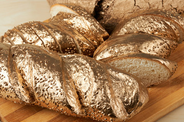 Group of gold metal bread