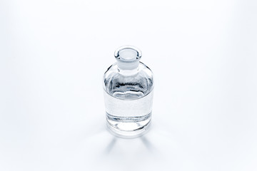 Jar of pure water on white background top view copy space