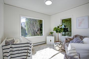 Light Nursery with white walls.