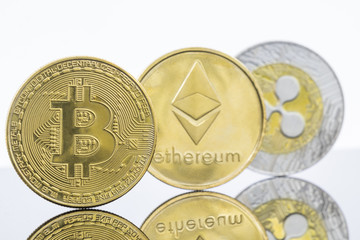 Gold Bitcoin, Etherium and Ripple Tokens in a row
