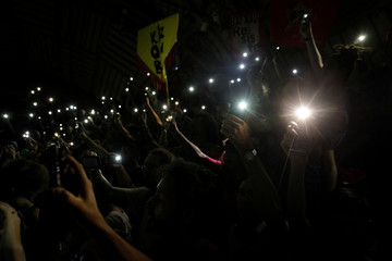 Participants turn on the light on their mobile devices on in tribute to late Rio de Janeiro city councilor Marielle Franco at a joint rally organized by left-wing political parties in Rio de Janeiro, Brazil