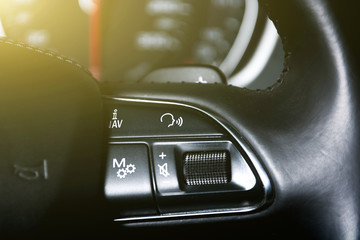 Cruise control and speed limiter buttons on the car steering wheel