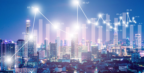 Business background with stock growth  market with city scape night business district background.