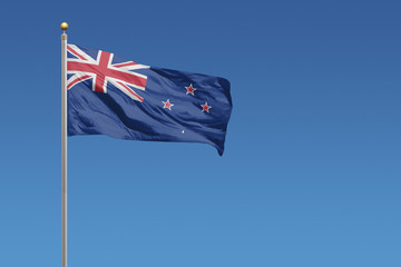 New Zealand Flag of in front of a clear blue sky