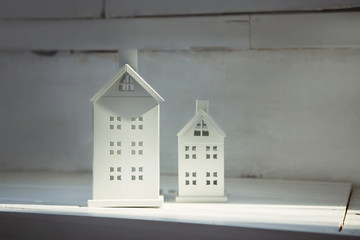 white miniature houses on a white background
