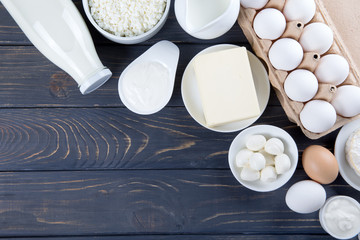 Spoed Fotobehang Zuivelproducten Dairy products on wooden table. Milk, cheese, egg, curd cheese and butter.