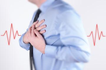 Geschäftsmann mit einem Herzinfarkt und einem EKG