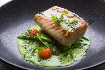 Photo sur Plexiglas Poisson Cooked white fish fillet