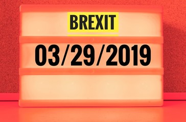 Luminous sign with inscription in english Brexit and 03/29/2019, in german 29.03.2019, symbolizing the withdrawal of Great Britain from the EU