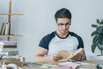 handsome male student reading book