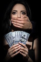 Bribery people with dollars in hand and shut your mouth. freedom of speach