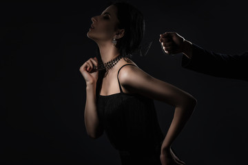 Male hand holds a sensual woman in collar. dominance concept
