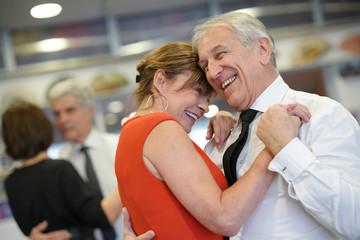 Senior couple attending dance class