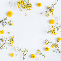 Flowers composition. Frame made of yellow flowers on gray background. Flat lay, top view, square, copy space