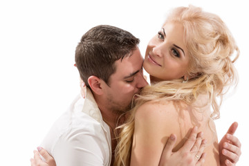 Young beautiful couple in intimate proximity, kissing and hugging