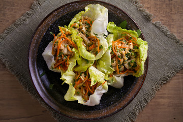 Stuffed iceberg lettuce cabbage leaves with chicken and vegetables. Wraps pockets of lettuce with chicken. overhead